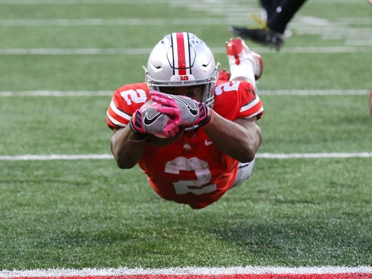 Ohio State Buckeyes running back J.K. Dobbins dives for the touchdown during the second half against Maryland.