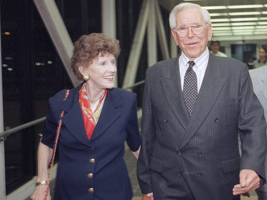 """In this 1997 photo The Rev. Robert Schuller leaves Los Angeles International Airport with his wife Arvella. Arvella Schuller, who helped her pastor husband found the Crystal Cathedral megachurch and hallmark """"Hour of Power"""" televangelism program  died on Feb. 11, 2014. She was 84."""