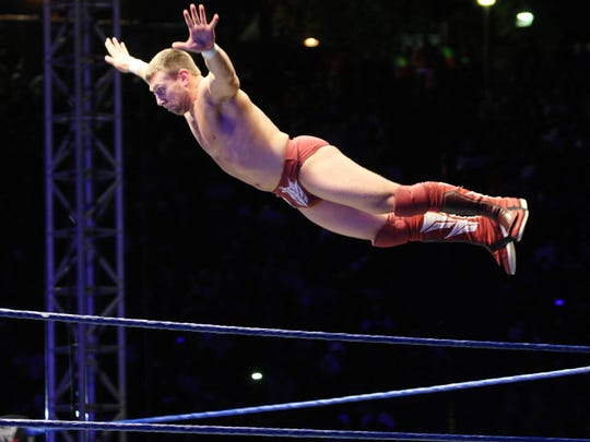 Daniel Bryan sails off the top rope during this 2011 WWE match in Durban, South Africa.