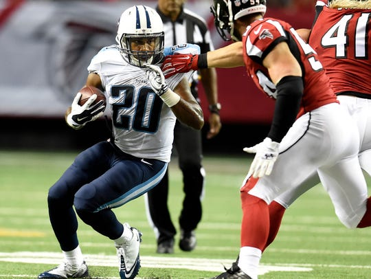Titans running back Bishop Sankey (20) slips away from