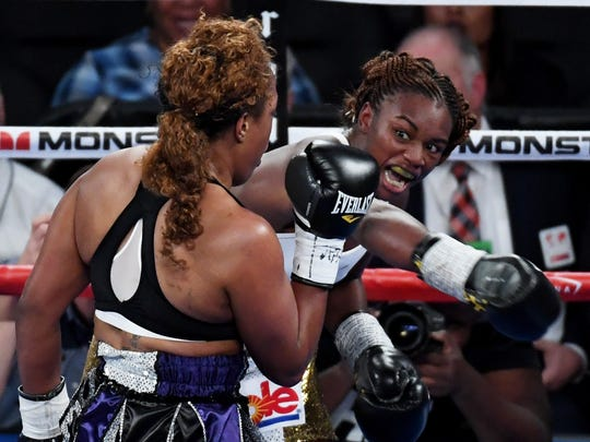 Claressa Shields throws a right at Franchon Crews in the second round of their super middleweight bout at T-Mobile Arena on November 19, 2016 in Las Vegas, Nevada. Shields won by unanimous decision.