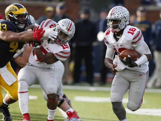 Ohio State running back Ezekiel Elliott blocks U-M's Scott Sypniewski as quarterback J.T. Barrett runs for a fourth-quarter touchdown in last year's 42-13 victory over the Wolverines at Michigan Stadium.