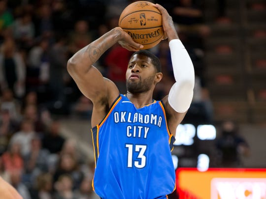 Oklahoma City Thunder forward Paul George (13) shoots the ball during the first quarter against the Utah Jazz at Vivint Smart Home Arena.