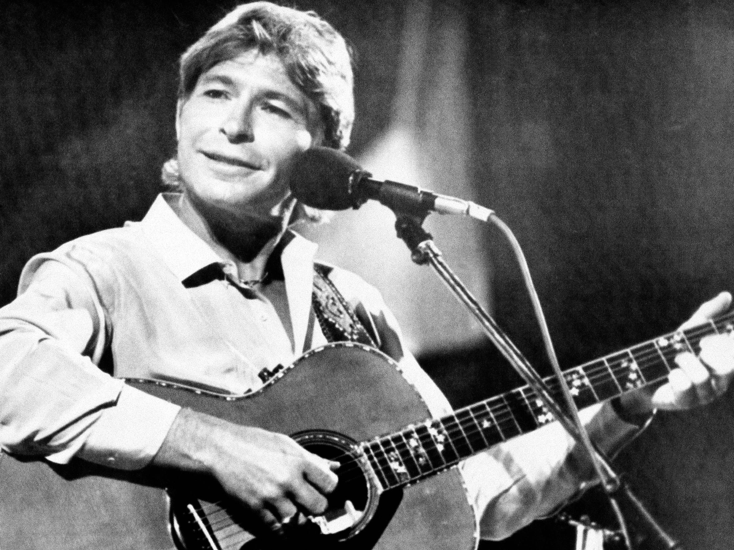 American singer John Denver appears during his concert at the Festival de la Cancion music festival in Vina del Mar, Chile, on Feb. 14, 1985.  Denver was killed in a small-airplane crash 12 years later.