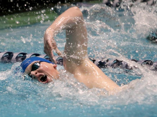 Olympic's Ross Burchell competes in the 500 Yard Freestyle