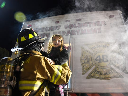 Kids are helped out of the Hershey Volunteer Fire Department's