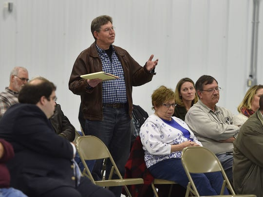Eric Corroy of Red River asks about the economic sustainability of a proposed anaerobic digester system during a meeting Monday in the expo building at the Kewaunee County Fairgrounds in Luxemburg.