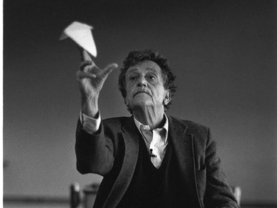 Kurt Vonnegut flies a paper airplane in his old grade school classroom in Indianapolis.