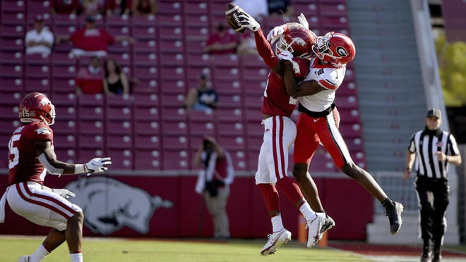 """Arkansas defensive back Montaric """"Busta"""" Brown (21) breaks up a pass intended for Georgia receiver George Pickens (1) on Sept. 26 in Fayetteville. Brown, among other players, is expected to return from injury this week against Texas A&M."""