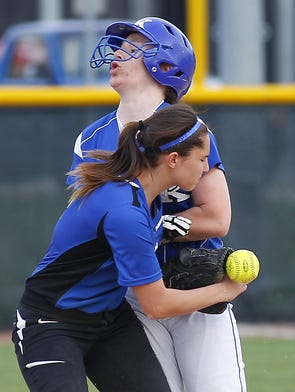 Walton-Verona's Hannah Thacker, left, loses the ball as Simon Kenton's (25) Samantha Perkins, runs into her.