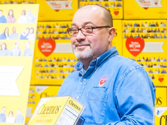 Mike Alvarez reacts to the new Cheerios box at ShopRite