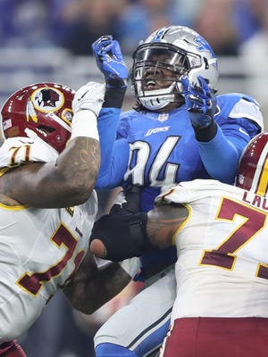 Lions defensive end Ziggy Ansah rushes against the Washington Redskins in the first half Oct. 23, 2016 at Ford Field in Detroit.