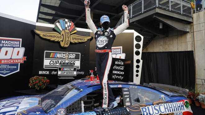 Kevin Harvick celebrates after winning the NASCAR Cup Series auto race at Indianapolis Motor Speedway on Sunday.