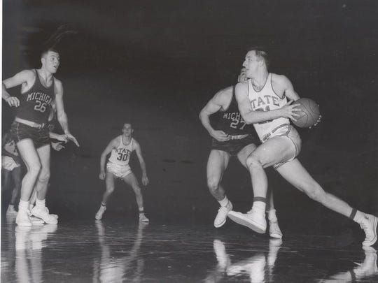 MSU All-American Jack Quiggle, right, scored 22 points to help the Spartans upset Kentucky, 80-68, on March 16, 1957 to help them reach their first Final Four.