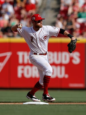 Cincinnati Reds shortstop Zack Cozart (2) throws to first for a double play in the top of the fourth inning against the Los Angeles Dodgers at Great American Ball Park on Saturday, June 17, 2017.