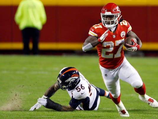FILE - In this Oct. 30, 2017, file photo, Kansas City Chiefs running back Kareem Hunt (27) runs past a tackle attempt by Denver Broncos linebacker Shane Ray (56) during the first half of an NFL football game in Kansas City, Mo. Hunt, a third-round pick out of Toledo, of all places, leads the league in rushing with 800 yards. (AP Photo/Colin E. Braley, File)