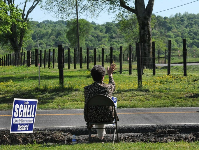 Volunteer Helen Freels waves to a neighbors and passerby's on Highway 25 near Gallatin during voting in Sumner County on Tuesday May 6, 2014, in Gallatin in Tenn.