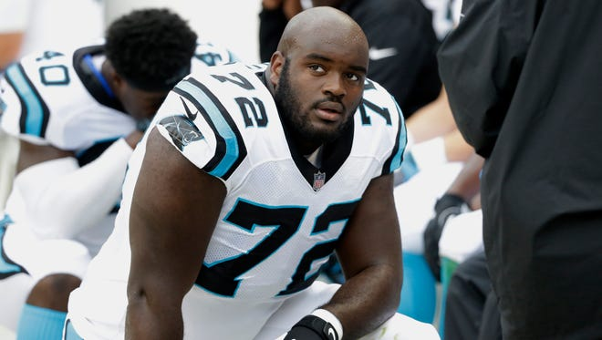 Carolina Panthers offensive tackle Taylor Moton (72) kneels in the bench area during the first half of an NFL football game against the Chicago Bears, Sunday, Oct. 22, 2017, in Chicago.