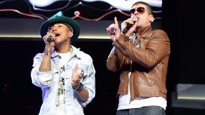 Robin Thicke (r) and Pharrell Williams on June 6, 2014, in Fayetteville, Ark.
