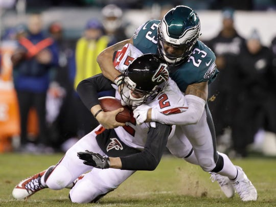 Philadelphia Eagles' Rodney McLeod (23) tackles Atlanta Falcons' Matt Ryan (2) during the second half of an NFL divisional playoff football game, Saturday, Jan. 13, 2018, in Philadelphia. (AP Photo/Matt Rourke)