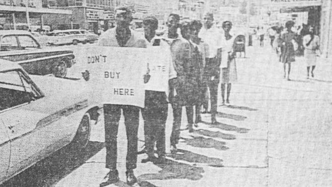 Marchers take part in a civil rights protest in 1963 in downtown Fayetteville, near the old Prince Charles hotel. Protests included boycotts and sit-ins.