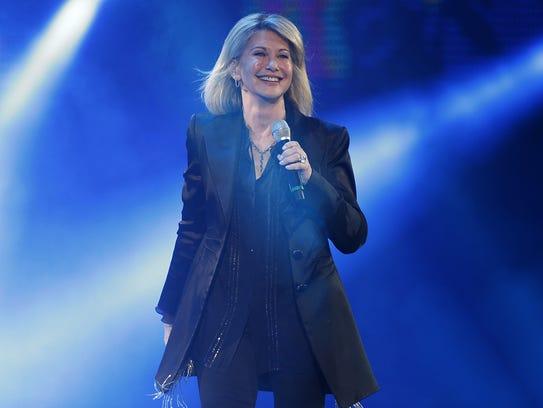 Olivia Newton-John performs at the 58th Vina del Mar