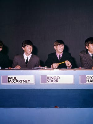 This file picture shows The Beatles (L-R), John Lennon, Paul McCartney, Ringo Starr and George Harrison in 1964, in London. The Fab Four were in their early 20s at the time.