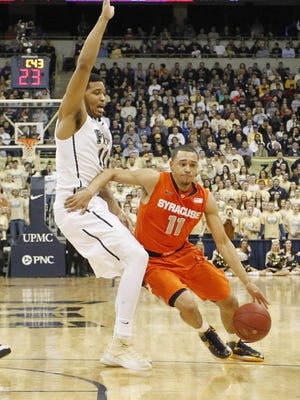 Syracuse Orange guard Tyler Ennis (11) drives to the basket around Pittsburgh Panthers forward Derrick Randall (left) during the first half at the Petersen Events Center.