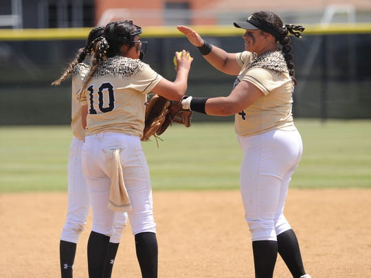 Abilene High first baseman Sydnee Killam (4) gives pitcher Kaylen Washington (10) a high-five following a strikeout during the Lady Eagles' 12-1, five-inning win against Fort Worth Paschal in Game 1 of the bi-district playoffs.