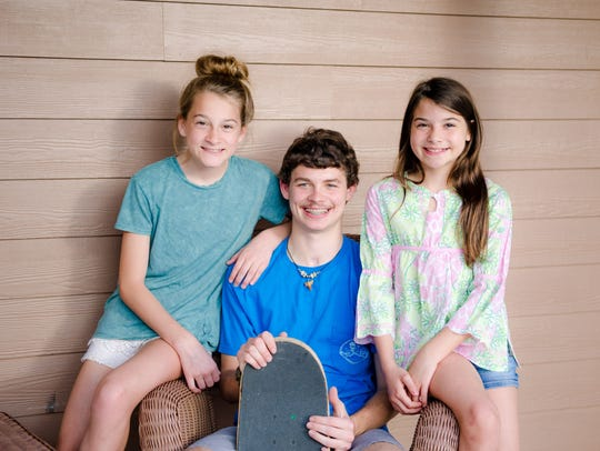 Hunter is pictured with two of his three sisters, Emily