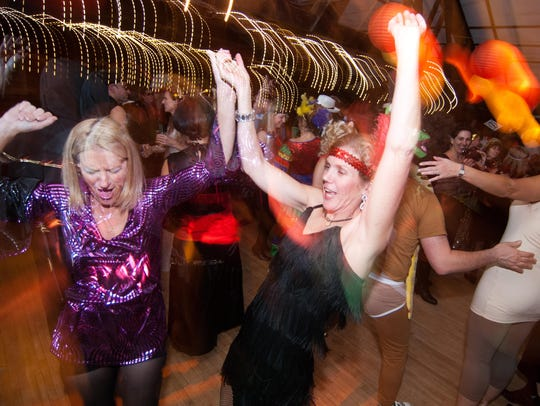 Guests dance at a Halloween party at the Old Lantern