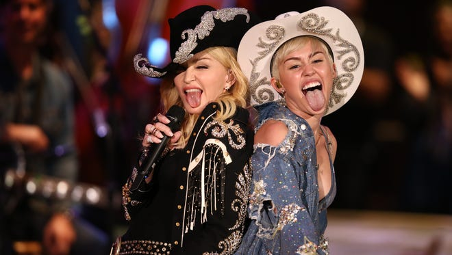 Madonna joins Miley Cyrus for the finale of Cyrus' MTV Unplugged taping Tuesday in Hollywood
