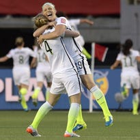 U.S. defenders Julie Johnston (19) and Becky Sauerbrunn (4) and their teammates will be looking to celebrate again tonight as they face Germany in the FIFA Women's World Cup semifinals.