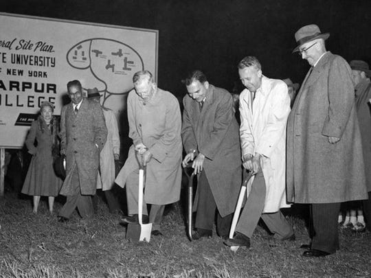 Gov. Thomas E. Dewey and others break the ground for Harpur College in 1954.