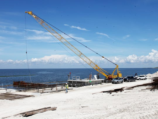 Crews with the Army Corps of Engineers work on improving the structural integrity of the Herbert Hoover Dike in Pahokee back in 2014.