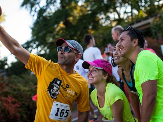 Runners pose for a photo during the Photo Finish 5K Saturday in Rochester.