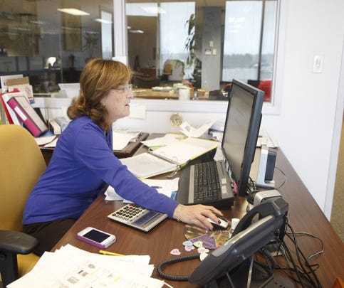 Jane Glazer at work at QCI Direct in 2013.