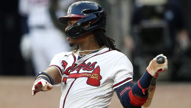 The Braves' Ronald Acuña Jr. follows through on an RBI double during the second inning of the team's game against the New York Mets on Saturday in Atlanta.