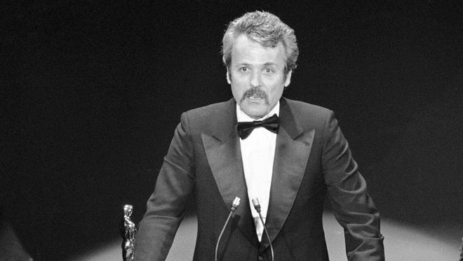 "William Goldman accepts his Oscar at Academy Awards in Los Angeles, for screenplay from other medium for ""All The President's Men."""