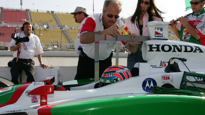 OrthoIndy's Dr. Terry Trammell takes a measurement of Indianapolis 500 race driver Tony Kanaan's car last May for a driver safety study.   GENERAL INFORMATION: <b>05/23/2009 - C06 - MAIN - 1ST - THE INDIANAPOLIS STAR</b><br />Dr. Terry Trammell measured Tony Kanaan's car last May for a driver safety study.