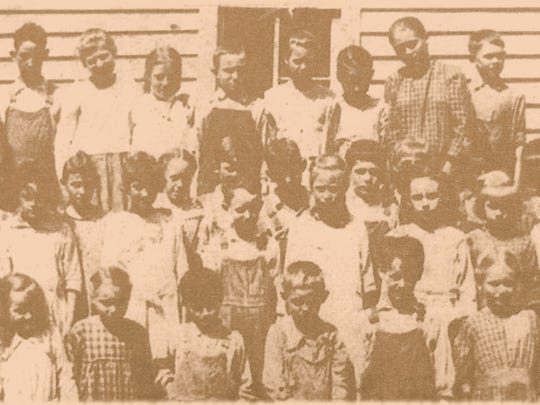 The Pilgrim's Rest School Class of 1920 are (back row, from left): Elbert Reynolds, Floyd Walton, Una Bayless, Mary Holman, Perry Marler, Nina Marler, Della Young, Ruther Marler and Arden Culvahouse; (third row) Edna Norris, Lella Stafford, Virgie Marler, Monroe Stafford, Henry Carson, Johnny Marler, Lenora Norris, unknown, William Homan and Earl Hopper; (second row) unknown, Virgil Hodges, Myrtle Reynolds, Cora Walton, Rex Reed, Erma Marler, Lona Walton, Cumi Marler, Ray Carson and Nina Messick; (first row) Nellie Hodges, Euna Hopper, Clima Messick, Alfred Pruitt, Edward Norris, Homer Hodges, Nellie Marler and Ernest Holman. Eight members married classmates.