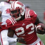 Wisconsin tailback Dare Ogunbowale, an economics major, realizes that securing a spot in the NFL is not a sure thing.
