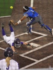 ACU's Taylor Brown slides into home with an inside-the-park