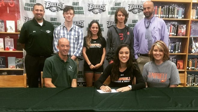 East Henderson senior Jade Baldwin has signed to run cross country and track for Campbell.