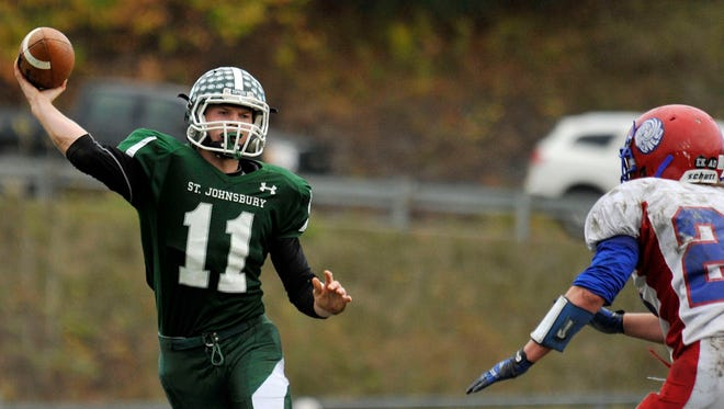 Colton Hudson tosses a pass during St. Johnsbury's Division I high school football quarterfinal win over Hartford.