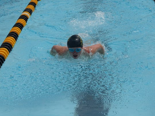 Sarah Gundler, 12, competes in the 50 butterfly this past Saturday during the Pataskala Porpoises' meet against the Baltimore Sea Lions.