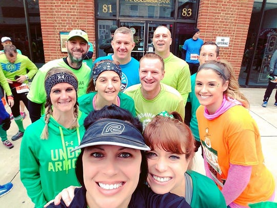 Members of the Waynesboro CFAR Runners pose for a photo before competing in last weekend's Saint Patrick's Day Running Festival Half Marathon in Hagerstown.