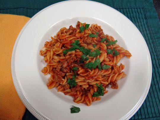 Ready to eat: pasta and sausage, with one pot to clean.