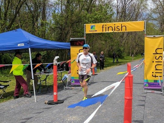 Chambersburg's David Dymond crosses the finish line during the 15K race portion of last weekend's Race, Run, Ride & Ramble. His official time of 1:12:40 was a PR.