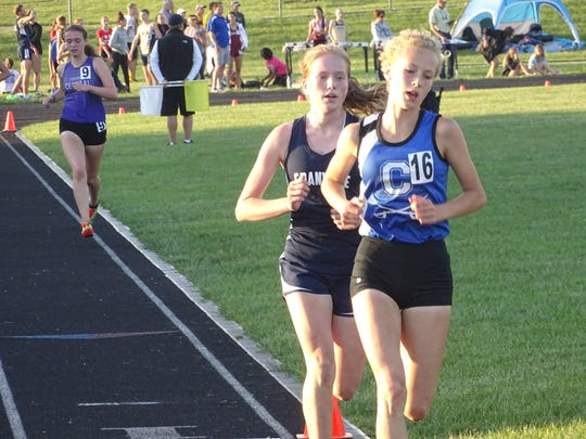 Granville freshman Reilly Zink trails close behind a Chillicothe competitor in the 3,200 this past Friday during the Division I regional meet at Pickerington North.